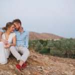 destination engagement photos of a beautiful couple in between the palm tree plantation in muscat , oman