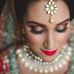sikh punjabi bride posing for a portrait photo during her asian london wedding