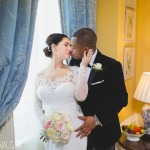 bride and groom kiss affectionately during a photo session in the Lanesborough Hotel