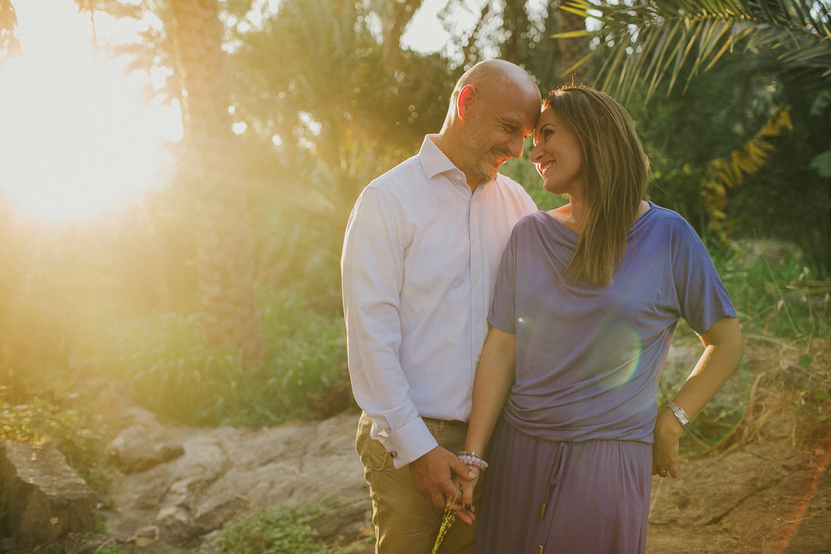 couple smiling to each other during a golden hour engagement session in Muscat, Oman