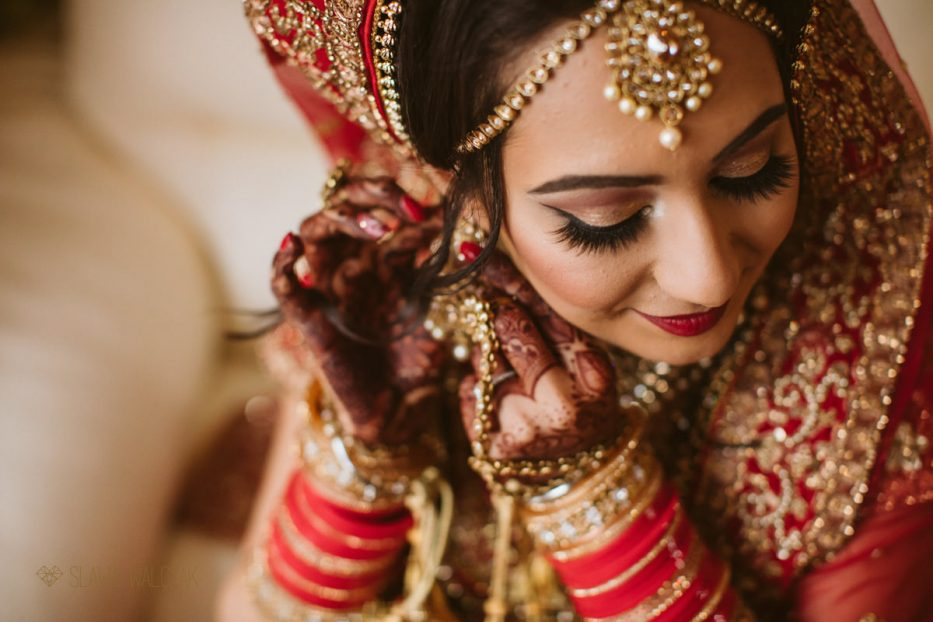 sikh wedding bride getting ready for her indian wedding in London