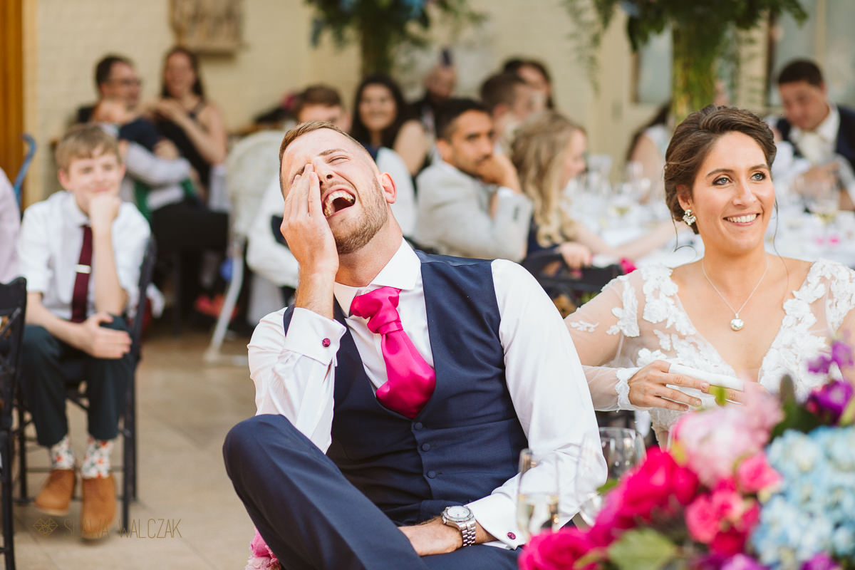 groom laughing during speeches at the Waddesdon Manor Wedding