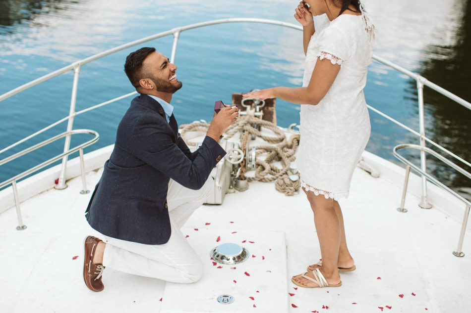 engagement photos on a yacht on a river thames in Hampton Court