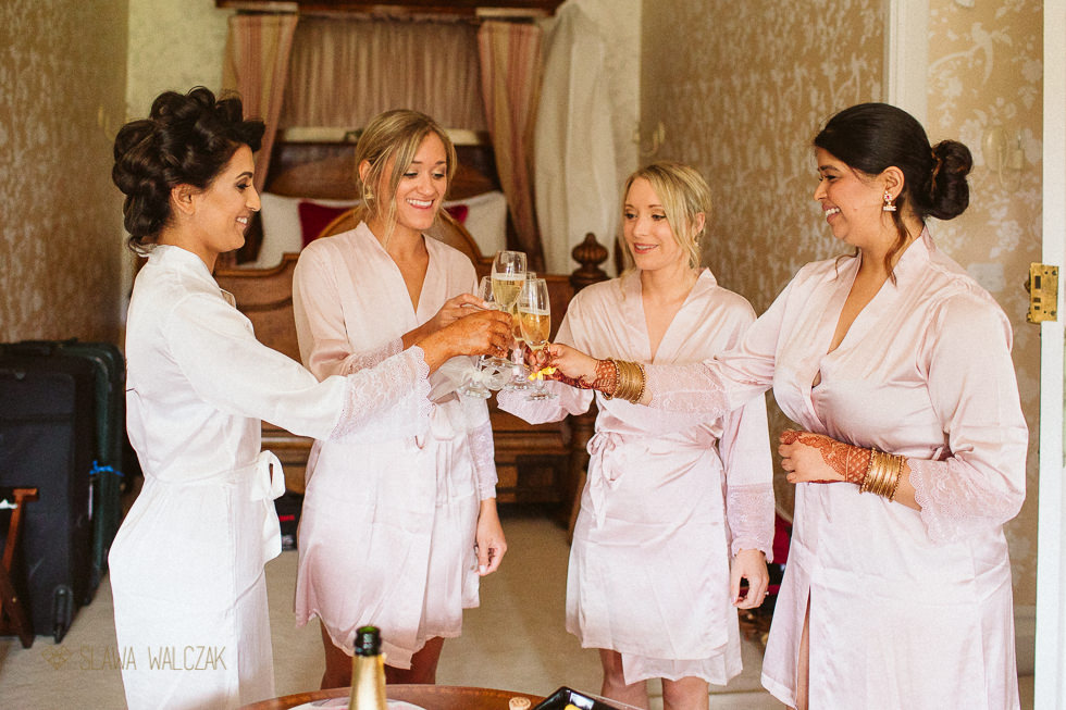 Bridesmaids getting ready for her wedding at Harlaxton Manor