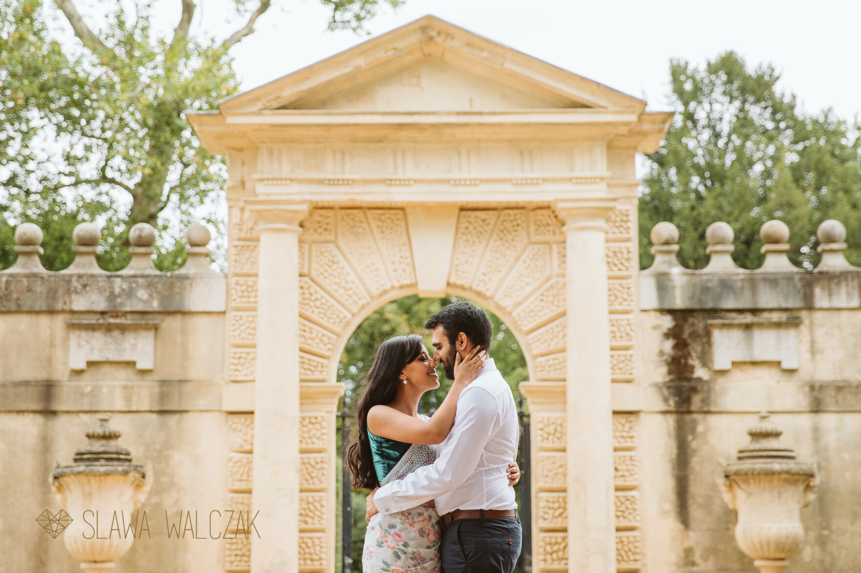 Natural and romantic engagement photo shoot Chiswick House Asian couple embrace each other romantically