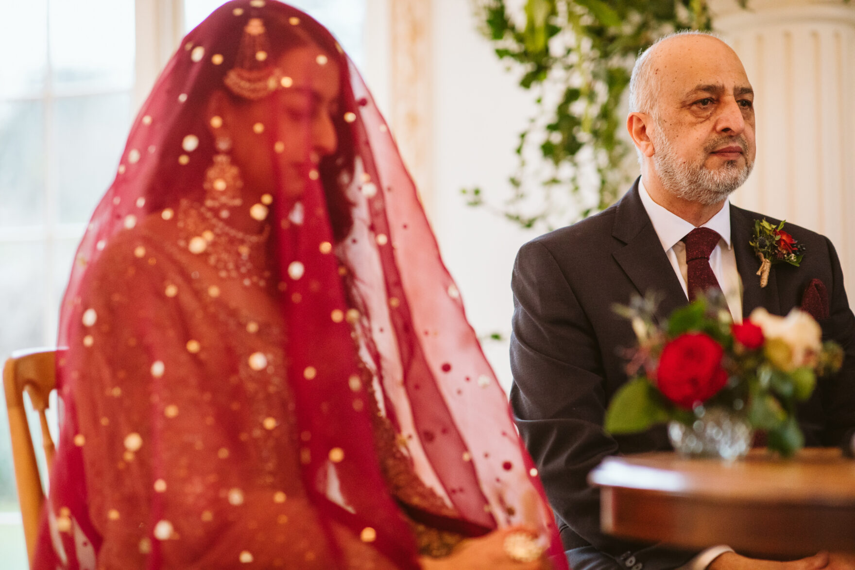 Asian Bride's father praying at a wedding ceremony