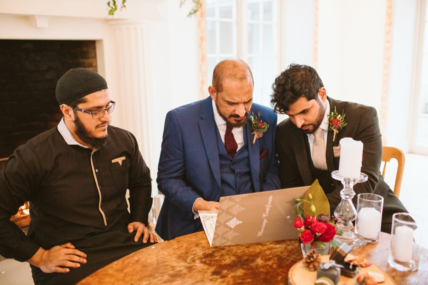 Islamic wedding photography London groom signing the documents